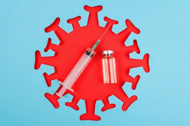 Seringa e ampola com vacina e vírus abstrato vermelho,