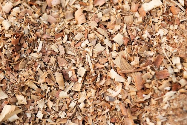 Serragem ou fundo de textura de pó de madeira. close up de madeira do fundo da textura do assoalho da serragem.