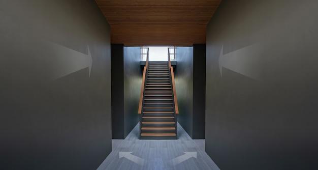 Seta na parede preta e escadaria, conceito de alcançar seu sucesso