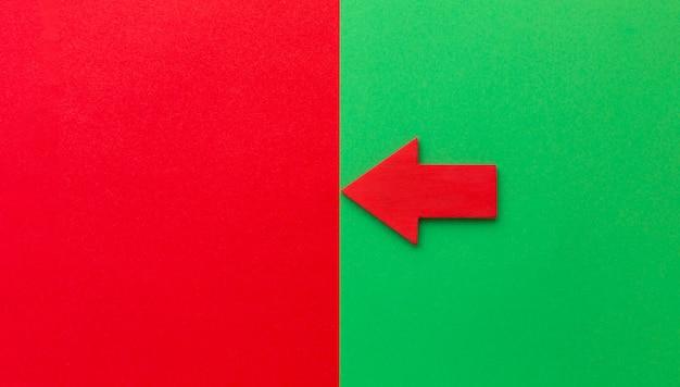 Seta vermelha apontando para a esquerda