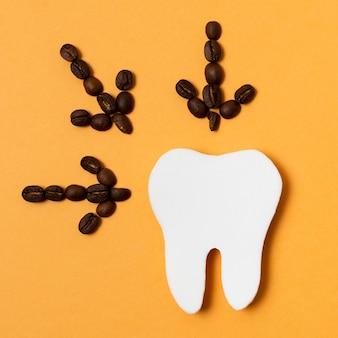 Setas de café com forma de dente