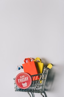 Sexta-feira sexta-feira, composição dos sacos no carrinho Foto gratuita