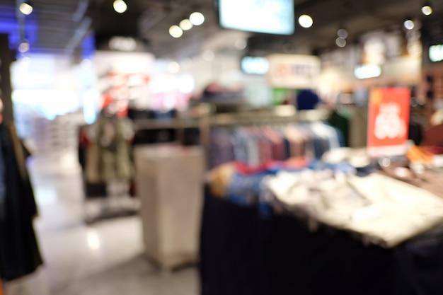 Shopping interior do borrão abstrato do armazém.
