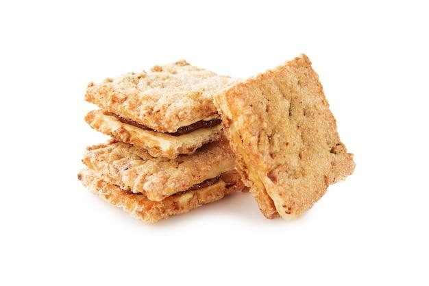 Shortbread cookies de diferentes formatos com recheio e sem isolados