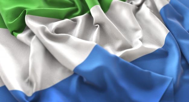 Sierra leone flag ruffled beautifully waving macro close-up shot