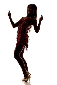 Silhueta de dançar magro mulher bonita sexy vestido vermelho e sapatos de salto alto, isolados sobre fundo branco