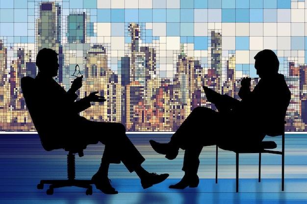 Silhueta de dois empresários tendo uma reunião