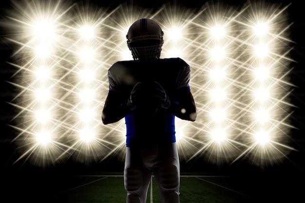Silhueta de um jogador de futebol com um azul