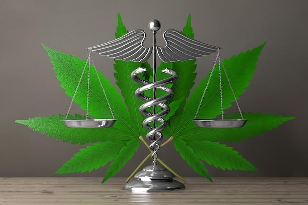 Símbolo do caduceu médico como escalas na frente da folha de cânhamo ou maconha medicinal em uma mesa de madeira. renderização 3d