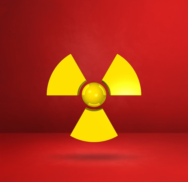 Símbolo radioativo isolado em um fundo vermelho do estúdio. ilustração 3d