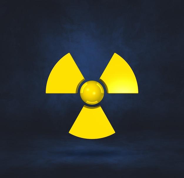 Símbolo radioativo isolado em uma superfície de estúdio azul escuro