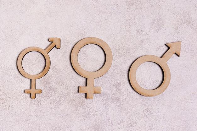 Sinais de gênero em fundo de mármore