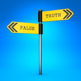 Sinal amarelo de direção bidirecional com as palavras falsas e verdade. conceito de escolha.