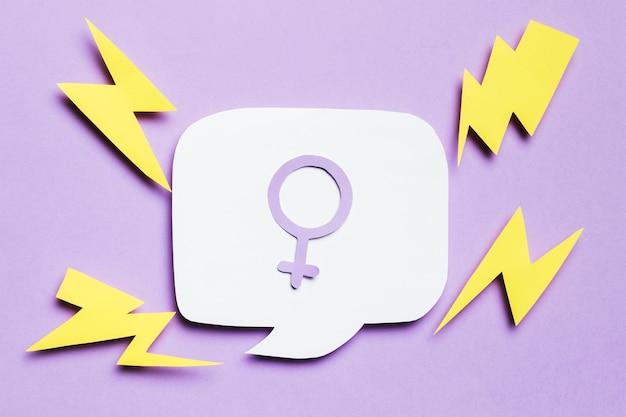 Sinal de gênero feminino na bolha do discurso, cercado por trovões