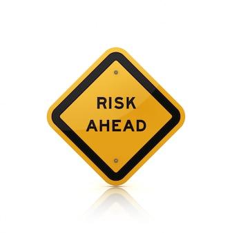 Sinal de trânsito com palavras à frente de risco