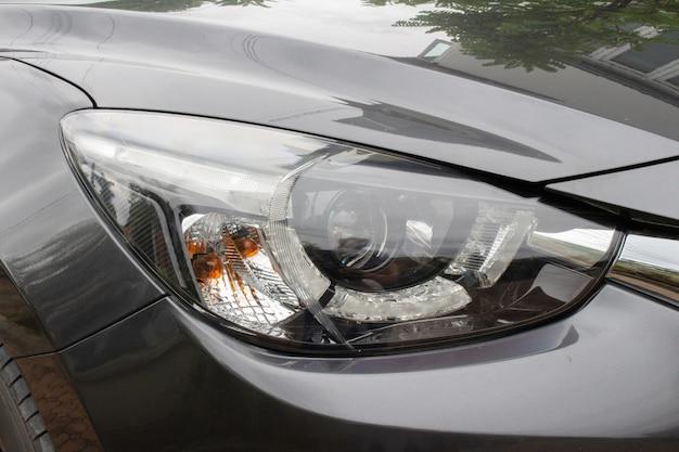 Sinal do estilo do olho da luz do farol do carro.