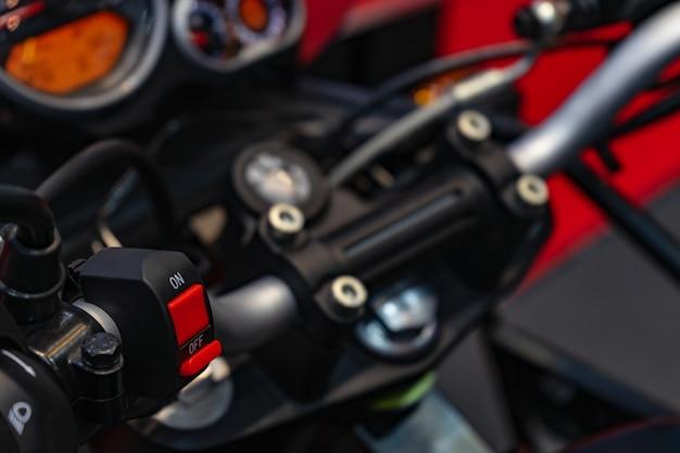 Sistema de parada de partida do guidão da motocicleta.