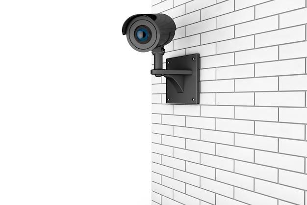 Sistema de segurança de câmera de vídeo sobre parede de tijolos em um fundo branco