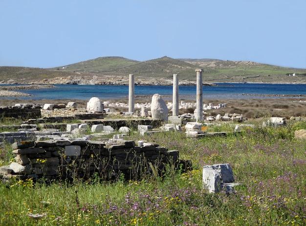 Sítio arqueológico de delos, o impressionante património mundial da unesco na ilha de delos, mykonos, grécia