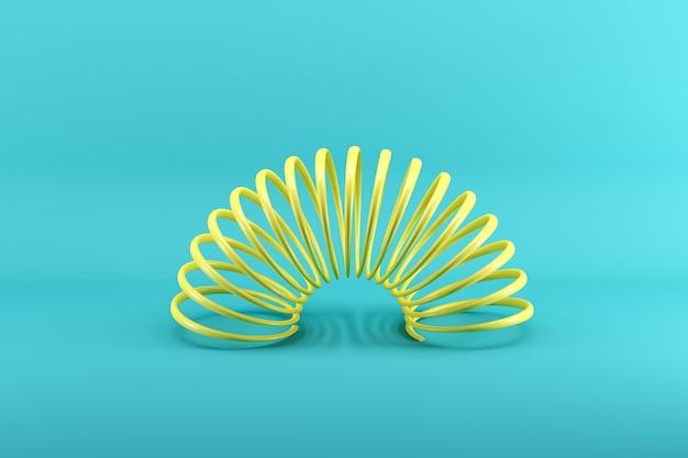 Slinky amarelo isolado em azul
