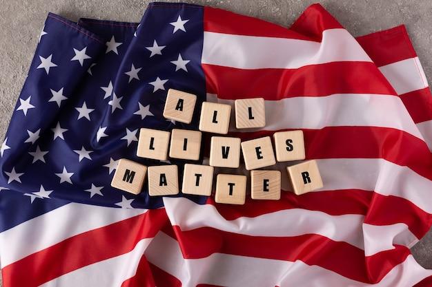 Slogan de all lives matter no fundo da bandeira americana