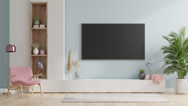 Smart tv na parede azul da sala de estar com poltrona, design minimalista, renderização em 3d