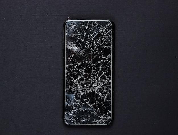 Smartphone com vidro de proteção quebrado