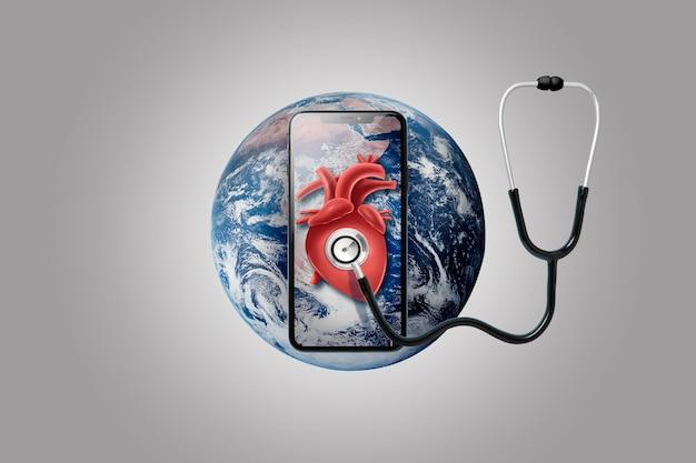 Smartphone na terra com estetoscópio no coração