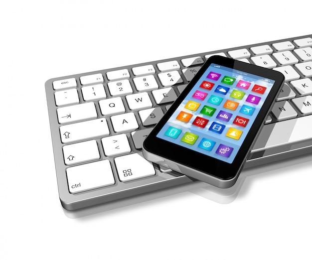 Smartphone no teclado do computador