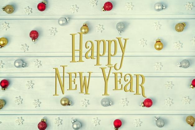 Sobre um fundo azul claro, a inscrição do feliz ano novo.