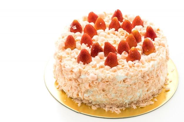 Sobremesa de bolo de baunilha com morango no topo