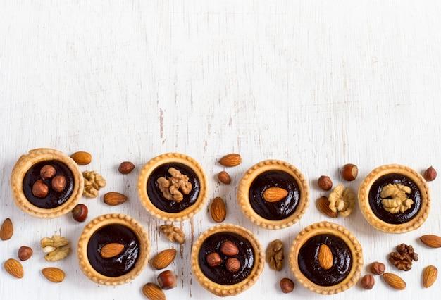 Sobremesas de fundo tortinhas de sobremesa de chocolate de noz