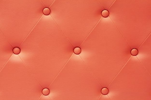 Sofá de couro laranja para plano de fundo