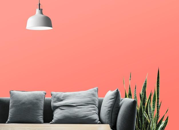 Sofá e cobra planta na sala de estar
