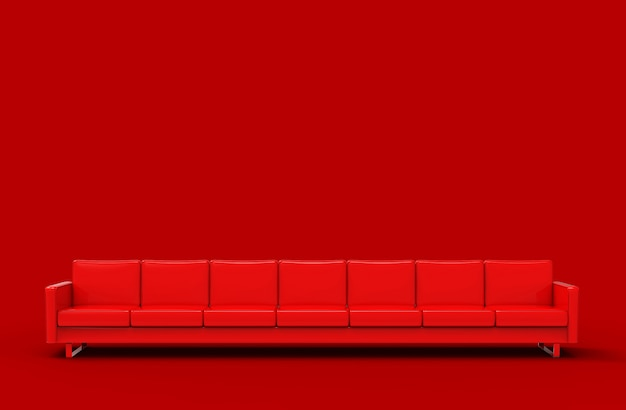 Sofá vermelho extremamente longo isolado no vermelho