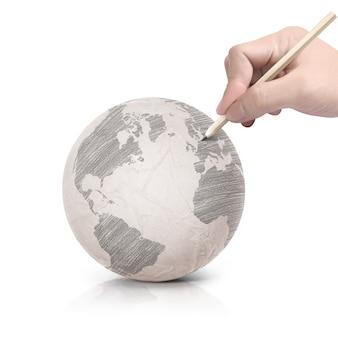 Sombra de desenho no globo da terra de papel