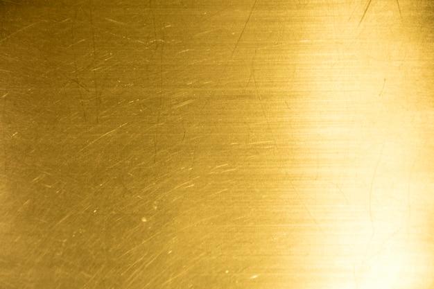 Sombra do fundo ou da textura e dos inclinações do ouro.