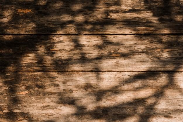 Sombra sobre o antigo cenário de madeira
