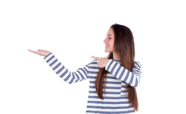 Sorrindo, menina adolescente, mostrando, algo, com, dela, mão