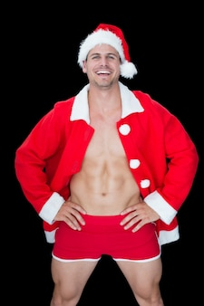 Sorriso homem musculoso posando em roupa santa sexy