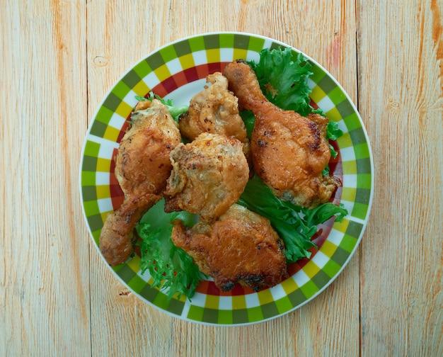 Southern fried chicken. uma rede de fast food com sede na grã-bretanha. culinária do sul dos estados unidos
