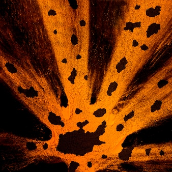 Splatter de pó de holi laranja com manchas pretas