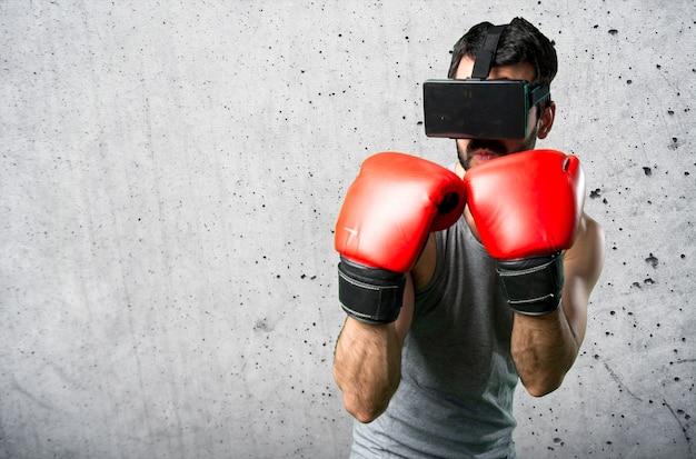 Sportman com luvas de boxe e óculos vr