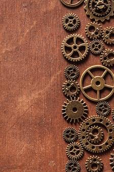 Steampunk rodas dentadas mecânicas engrenagens no fundo de madeira
