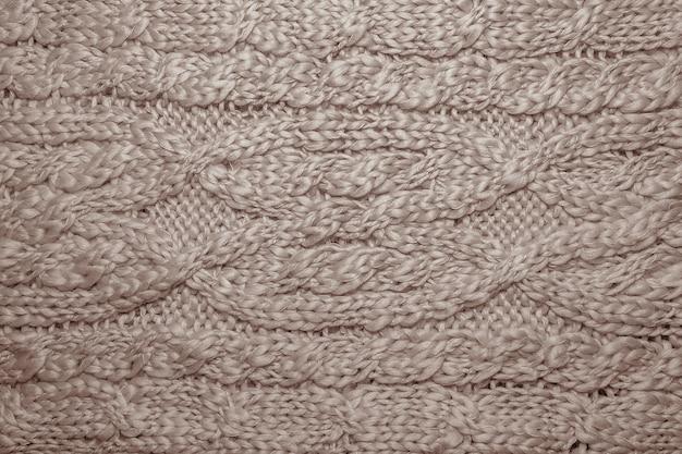 Suéter de lã ou textura lenço close-up. fundo de malha de malha com padrão em relevo