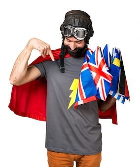 Super-herói com muitas bandeiras apontando para baixo