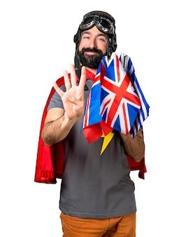 Super-herói com muitas bandeiras contando quatro