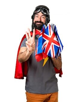 Super-herói com muitas bandeiras contando três