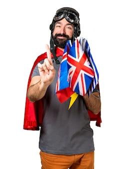 Super-herói com muitas bandeiras contando um