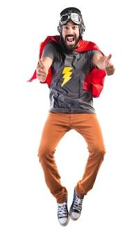 Super-herói com o polegar para cima